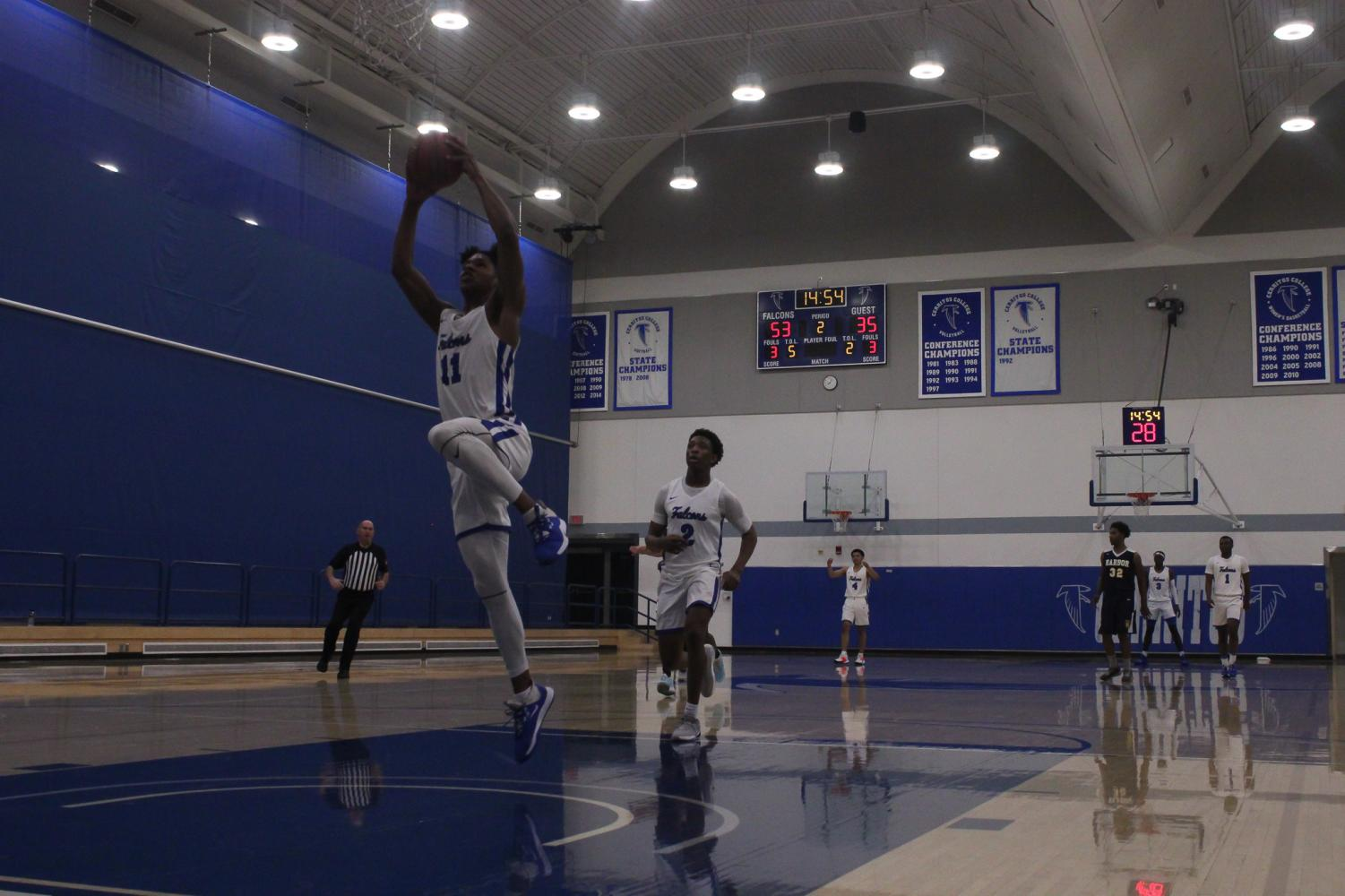 Falcons forward No. 11, Jaishon Forte, steals the ball from a Cougar player and dunks it at the end of the play. Cerritos men's basketball played LA Harbor college on Feb.7, 2020. Photo credit: Keanu Ruffo
