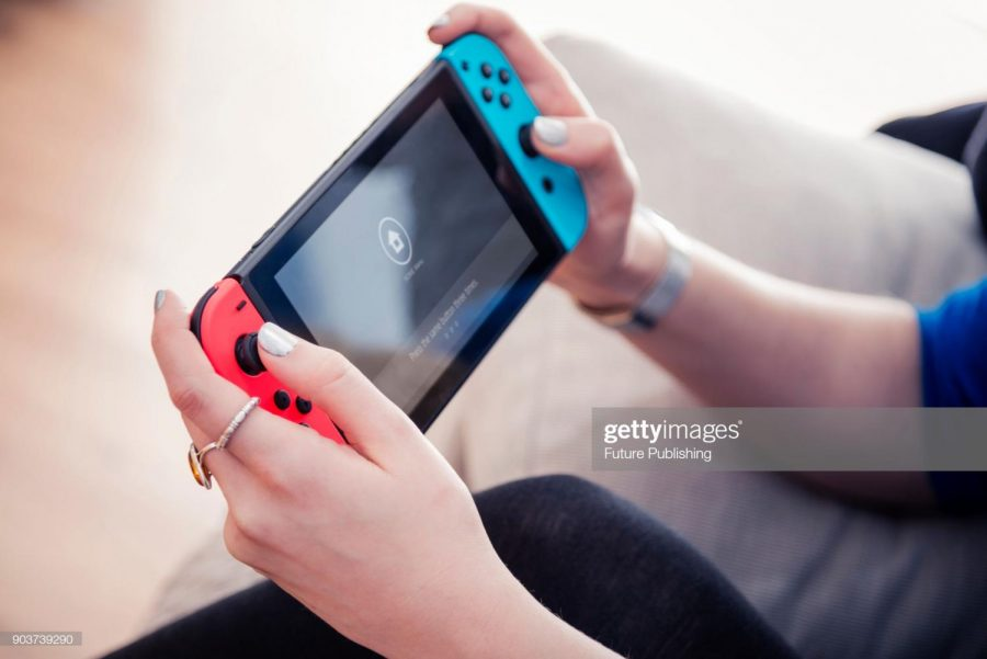 Detail+of+a+young+woman+playing+video+games+on+a+Nintendo+Switch+home+console%2C+taken+on+March+7%2C+2017.+