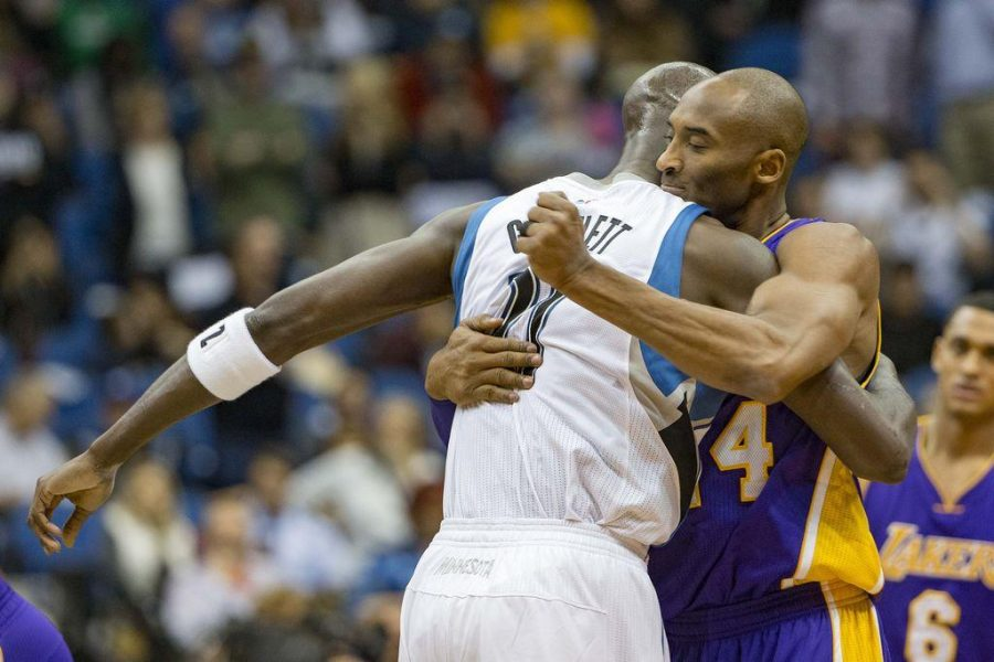 Los Angeles Lakers forward Kobe Bryant (24) hugs Minnesota Timberwolves forward Kevin Garnett (21) before the game at Target Center. Photo by Jesse Johnson-USA TODAY Sports
