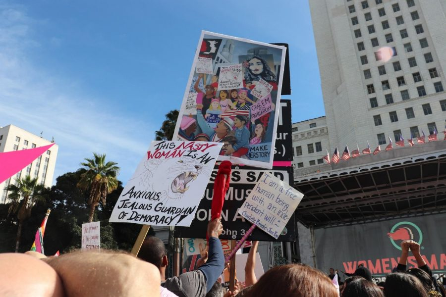 Some of the many posters and signs people carried around on display during the Women's March. The Women's March started at Pershing Square in Downtown LA and ended in front of City Hall with a rally on Jan.18,2020. Photo credit: Jazmin Aguayo