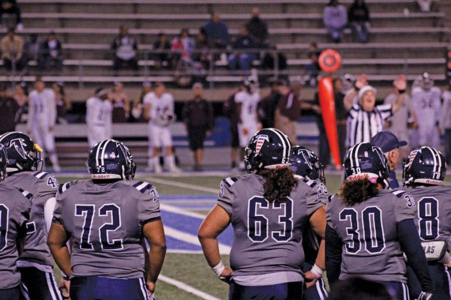 Cerritos College football team members watch the action from the sidelines. They wait for their opportunity to get back on the field Nov. 2, 2019