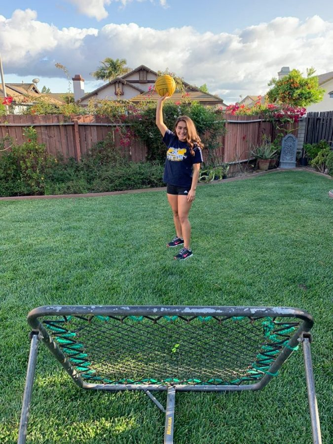 Mia Carbajal shows her backyard set up to practice water polo drills at home.