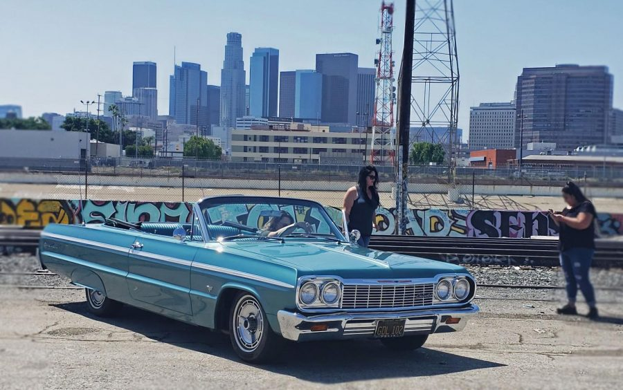 Las+chicas+gather+around+this+beautiful+classic+top-down+in+front+of+the+Los+Angeles+skyline.+The+perfect+car+to+take+to+the+beach.+