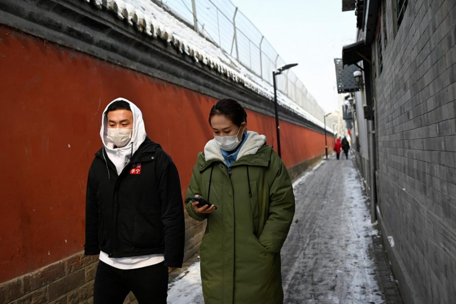 People+wearing+protective+face+masks+walk+through+an+alley+in+Beijing+on+Friday%2C+Feb.+7%2C+2020.+%28AFP%2FGetty+Images%2FTNS%29
