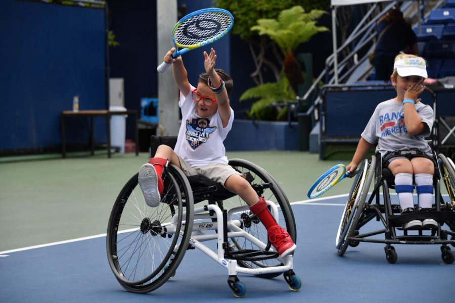 The+wheelchair+tennis+team+celebrates+during+the+Angel+City+Games.+This+year%27s+games+will+be+held+virtually+for+all+competitors+starting+in+June%2C+2020.+Photo+credit%3A+Courtesy+of+Angel+City+Sports+Founder