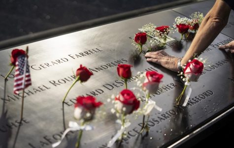 Roses laid out in memory of Sept. 11 victims. Family members gathered to honor their loved ones on the 19th anniversary of the attacks. Photo credit: Ben Hider &  9/11 Memorial & Museum