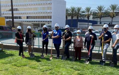 FoodHelp Board and staff don hardhats on the grounds where the new facility is going to be constructed. Excitement filled the air as they imagined the new facility. Photo credit: Jacqueline Cochran