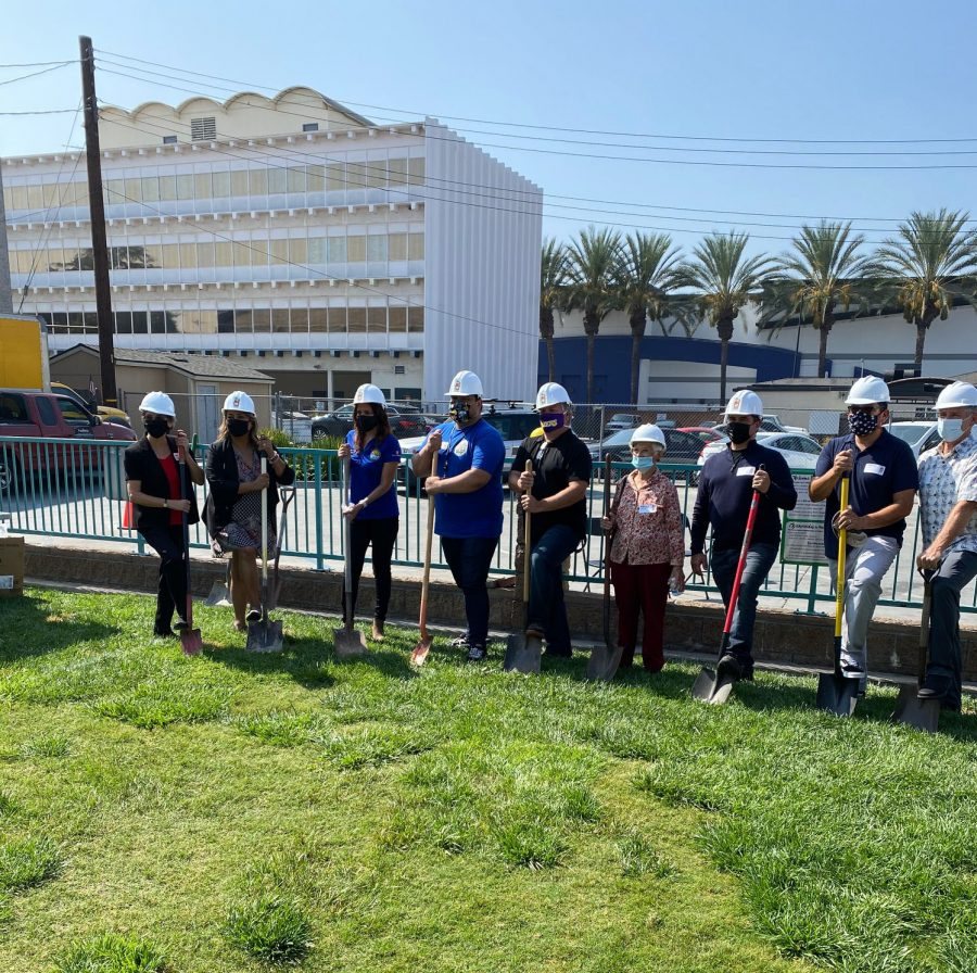 FoodHelp Board and staff don hardhats on the grounds where the new facility is going to be constructed. Excitement filled the air as they imagined the new facility.