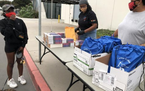 The Umoja Success Program prepares a college student care-package filled with a binder, notebook and miscellaneous school supplies on Sept. 10. Photo credit: Daniel Suarez Jr.