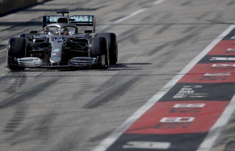 Mercedes driver Lewis Hamilton of Britain enters pit lane during Formula One