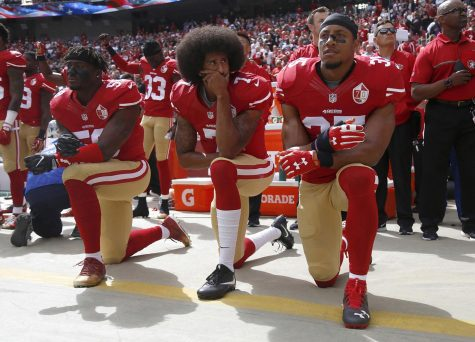 Eli Harold (58), Colin Kaepernick (7) and Eric Reid (35) of the San Franciso 49ers kneel during the national anthem before a game against the Dallas Cowbowy on October 2, 2016, at Levi