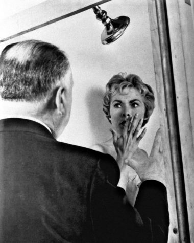 Photo of Janet Leigh and Alfred Hitchcock during the filming of Psycho. 1960.