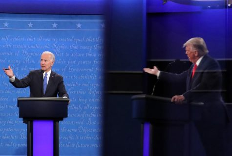 Democratic presidential nominee Joe Biden and U.S. President Donald Trump, shown in a reflection, participate in the final presidential debate at Belmont University on October 22, 2020 in Nashville, Tennessee. This is the last debate between the two candidates before the election on November 3.