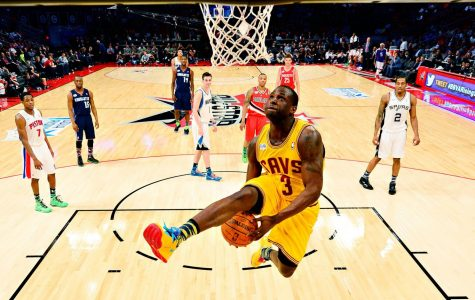 A member of the Cavaliers is attempting an alley-oop. The NBA is currently being questioned if they support the BLM movement.
