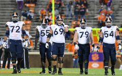 CLEMSON, SC - OCTOBER 03: The Virginia Cavaliers offensive linemen make their way down field during the game between the Clemson Tigers and the Virginia Cavaliers on October 03, 2020 at Memorial Stadium in Clemson, South Carolina. (Photo by Dannie Walls/Icon Sportswire) Photo credit: Photo by Dannie Walls/Icon Sportswire