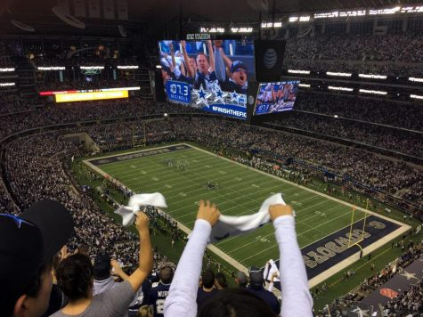 Cowboys fans cheer on their team as the Dallas Cowboys battled against the Detroit Lions in the first round of playoffs. The Cowboys and Lions are the only two teams that play every year on Thanksgiving day. Photo credit: Victor Araiza