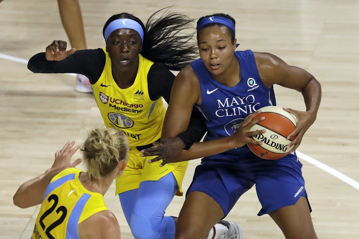 Lynx forward Napheesa Collier gets fouled by Chicago Sky guard Diamond DeShields during the first half of a WNBA game Thursday in Bradenton, Fla.