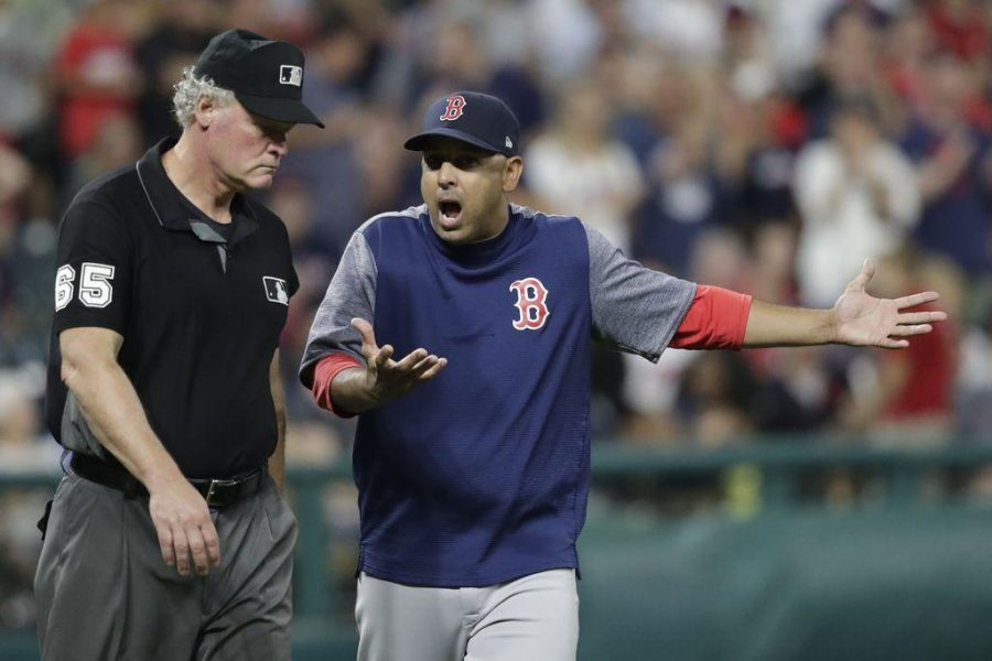 From a close call at third base in the eighth inning to some pitching decisions that were sure to draw a raised eyebrow, Red Sox manager Alex Cora (shown arguing with umpire Ted Barrett) was all in Tuesday night. Photo credit: The Providence Journal