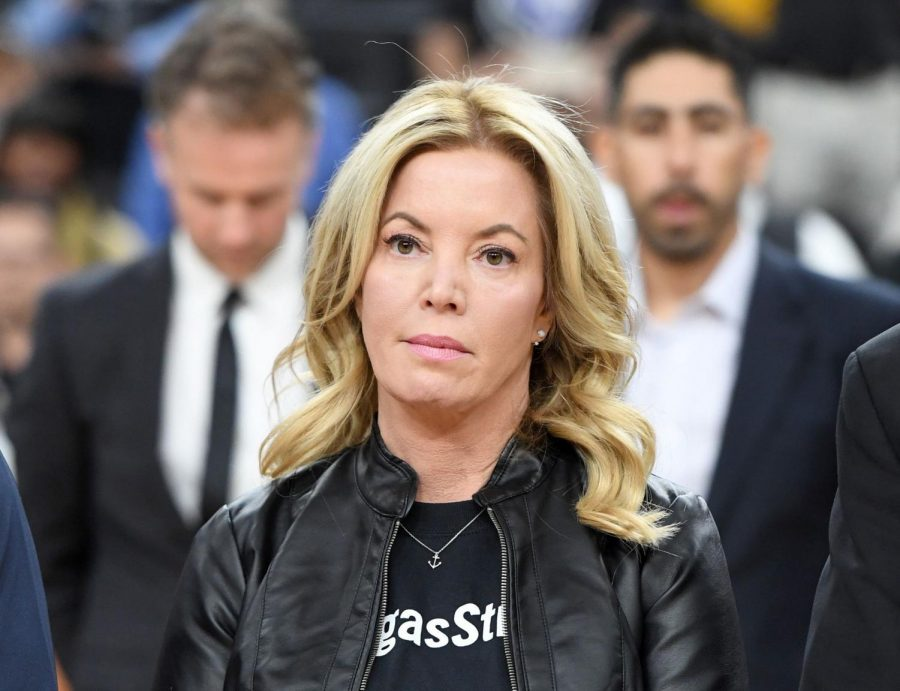 LAS VEGAS, NV - OCTOBER 08:  Controlling owner and President of the Los Angeles Lakers Jeanie Buss stands on the court during a moment of silence held to honor victims of last Sunday's mass shooting before the Lakers' preseason game against the Sacramento Kings at T-Mobile Arena on October 8, 2017 in Las Vegas, Nevada. On October 1, Stephen Paddock killed at least 58 people and injured more than 450 after he opened fire on a large crowd at the Route 91 Harvest country music festival. The massacre is one of the deadliest mass shooting events in U.S. history. Los Angeles won 75-69. Photo credit: Photo by Ethan Miller/Getty Images