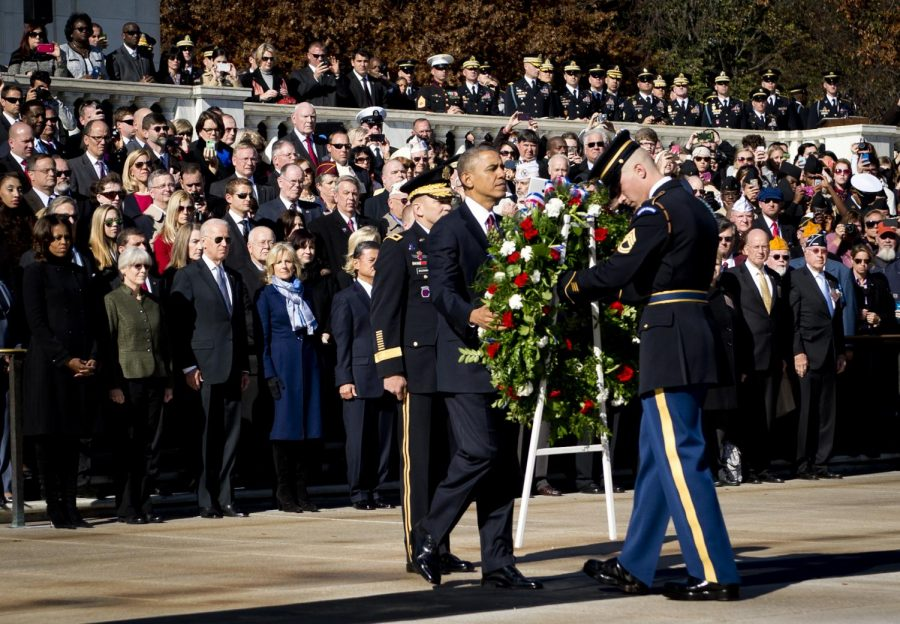 President Barack Obama sets a commemorative wreath  at the Tomb of the Unknowns at Arlington National Cemetery. Veterans Day, Nov. 11, 2013. Photo credit: Courtesy of U.S. Army on Flicker.com & Photo by Spc. John G. Martinez