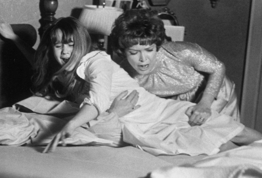 Linda Blair and Ellen Burstyn on set during the filming of The Exorcist. Photo credit: Image from Wikimedia Commons, taken Feb 12th 1974. (Public Domain)