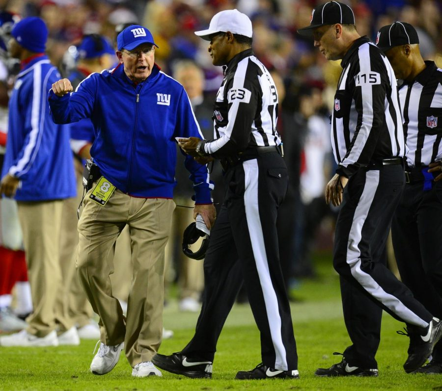 New York Giants head coach Tom Coughlin complains to Referee Jerome Boger (23) during the fourth quarter against the Washington Redskins at FedEx Field in Landover, Maryland, Monday, December 3, 2012. The Redskins defeated the Giants, 17-16. Photo credit: Harry E. Walker/MCT