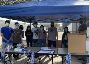 Students volunteered for this year's Turkey Trot drive-thru event, All volunteers wore masks and gloves to adhere to COVID-19 safety guidelines.  Nov. 20, 2020 Photo credit: Eileen Osuna