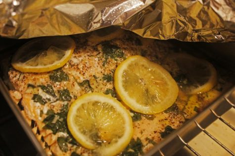 Lemon slices are the key ingredient in making a delicious flavorful baked salmon dish. Simple ingredients yet bold piquancy. Photo credit: Rebecca Aguila