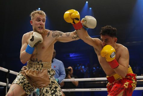 Jake Paul and AnEsonGib exchange blows during a boxing match in January. YouTubers are finding new ways like boxing to gain clout and boost their popularity in the entertainment world. Photo credit: Michael Reaves/ Getty Images