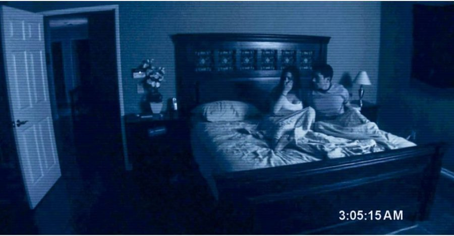 An+iconic+scene+from+the+first+Paranormal+Activity+where+Katie+and+Micah+experience+a+haunting.+Photo+credit%3A+Image+credit%3A+Blumhouse+Productions%2FParamount+Pictures