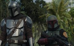 The Mandalorian (Pedro Pascal) and Boba Fett (Temuera Morrison) in Lucasfilm's THE MANDALORIAN, season 2, exclusively on Disney+. © 2020 Lucasfilm Ltd. & ™. All Rights Reserved. Photo credit: Walt Disney Company & Lucasfilm Ltd.