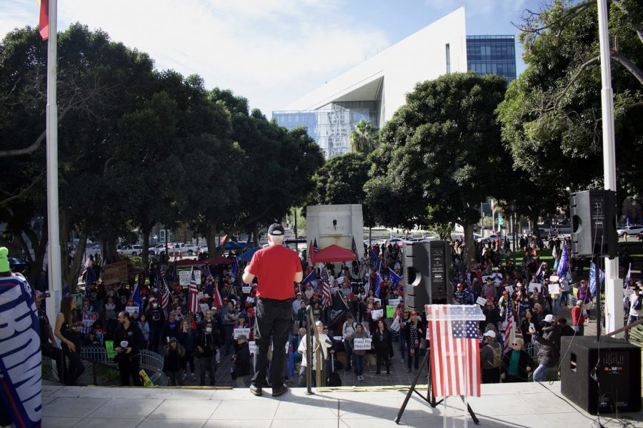 Political figures and priests touted conspiracy theories to the maskless crowd on Jan. 6 in front of Los Angeles city hall. They believe the presidential election was stolen by Democrats and China.