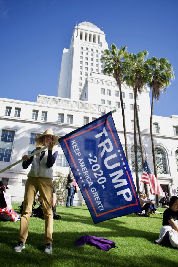 Trump supporter Donna Kaye protests the presidential election at Los Angeles city hall on Jan. 6. She believes the election was stolen because News Max continues to give voice to conspiracy theories on how Democrats rigged the election.