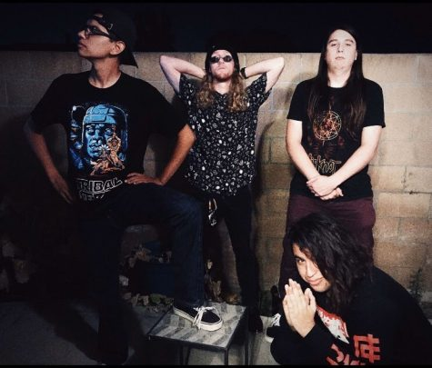 A picture of the band with it's current line up. From left to right: Carlos (guitar), Eric (bass guitar), Xander (guitar), and Miguel (vocals).