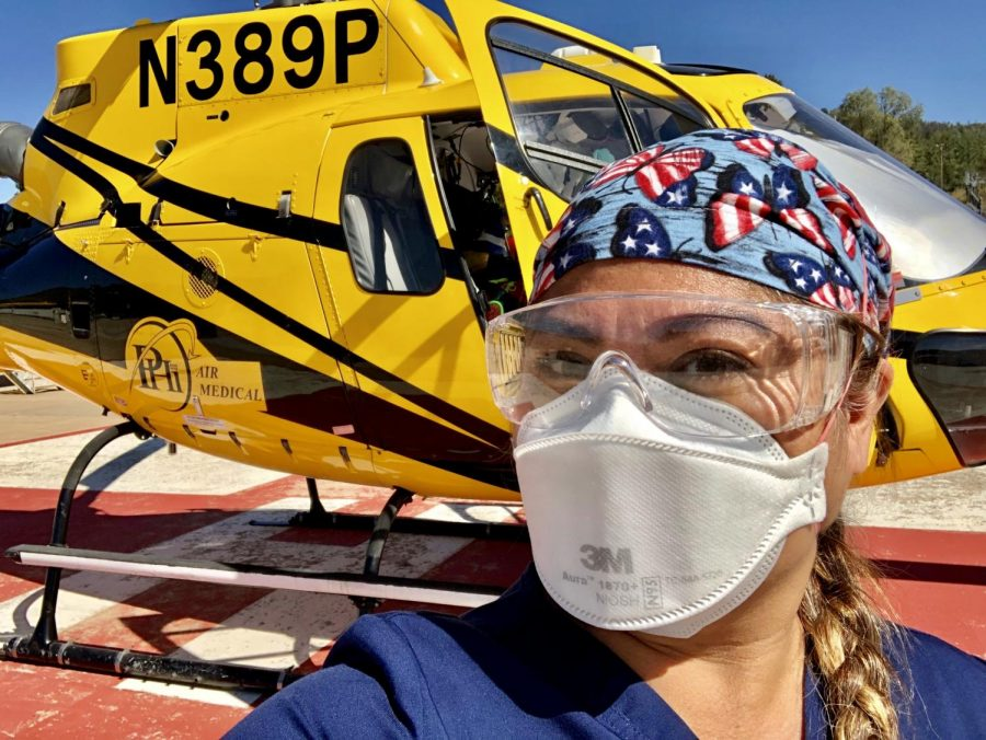 Registered Nurse Ana Valdoria, wears a mask as she arrives at White River, Arizona on Aug. 14. Valdoria was deployed to assist with the Apache Tribe and Navajo Nation COVID-19 patients.