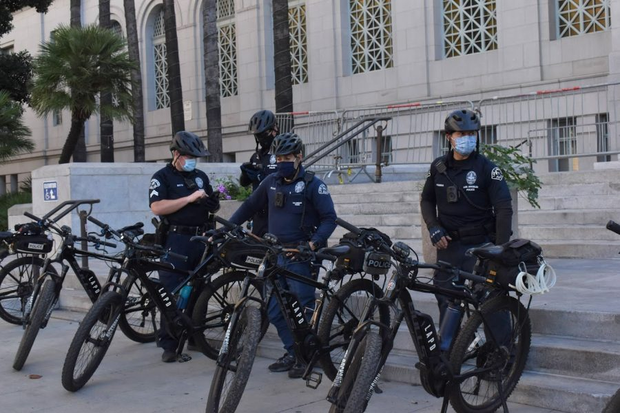 LAPD officers rode on bicycles to patrol the area around Los Angeles City Hall on Jan. 20. There were no notable Trump protests in LA on inauguration day. Photo credit: Vincent Medina