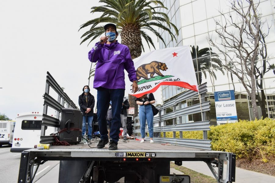 SEIU Labor Organizer, Felipe Caceres, gives a powerful speech to the pro-immigration caravan. SEIU and several other organizations called for immigration reform during the caravan at LAX on Jan. 27. Photo credit: Vincent Medina