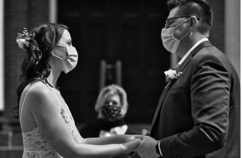 A couple from Loudoun County getting married in front of a courthouse during COVID-19 pandemic.