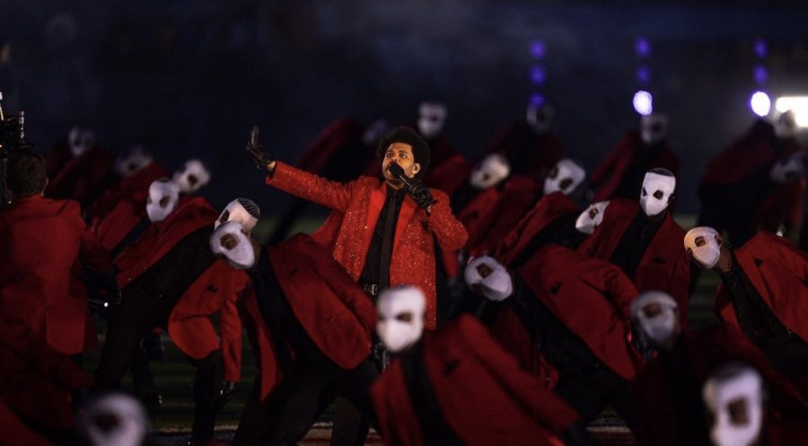 The Weeknd alongside a group of backup dancers on the Raymond James Stadium filed during the halftime performance. Photo credit: The Weekend
