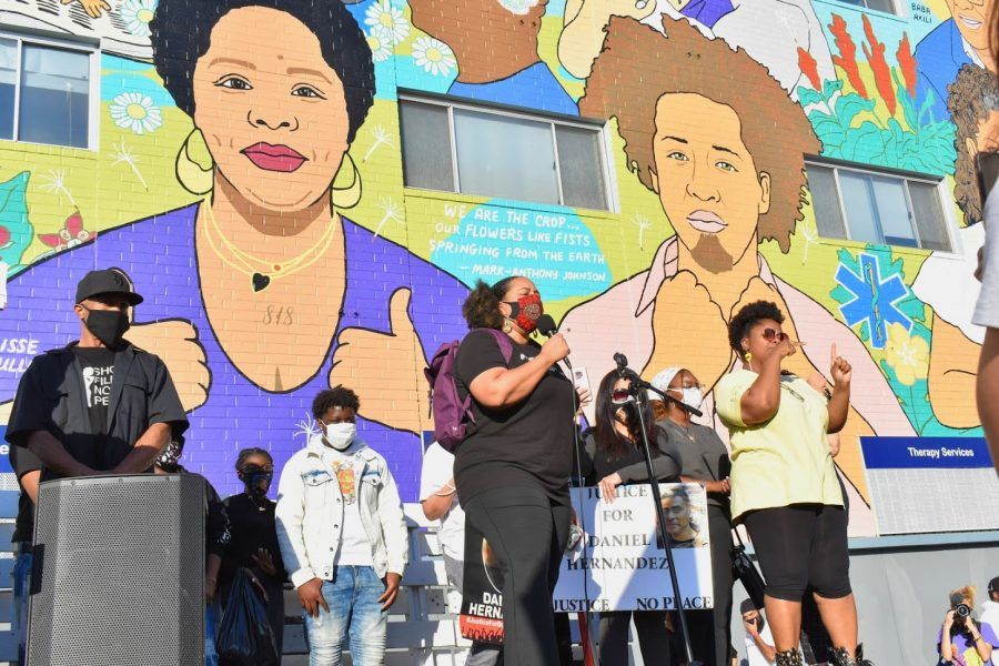 Black Lives Matter organizer, Tabatha Jones Jolivet, calls for the defunding of the LAPD at a rally on Feb. 24, 2021. She called for justice for the victims of police brutality outside the LA Police Protection League.