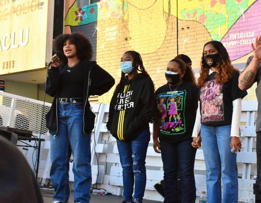 Black Lives Matter supporter introduces the BLM youth leaders during a rally on Feb. 24, 2021. (From left to right) Kahila Wiliams, 17, Ariana Fields, 18, Allia Fields, 17, feel that the police should be defunded in public schools as well.