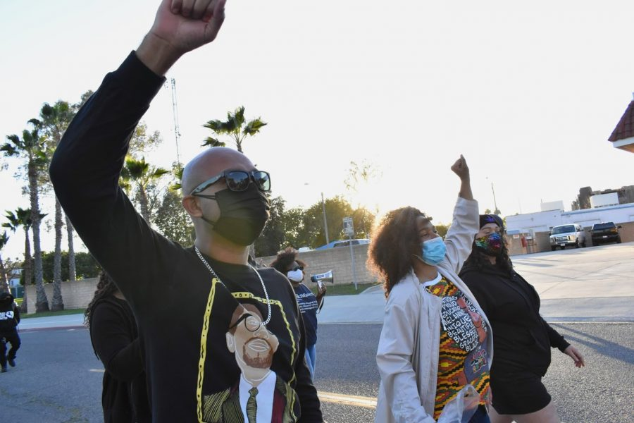 To honor Black History Month, dozens march through Marina Park in Long Beach on Feb. 20, 2021. They advocated for justice reform and the defunding of law enforcement.