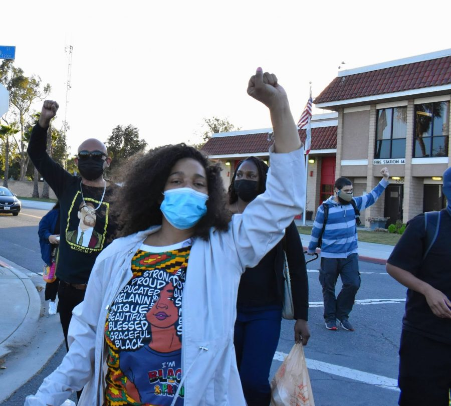 Marchers sang and chanted Im Black and Im proud, during a Black History Month celebration and march in Long Beach on Feb. 20, 2021. They raise their fists in solidarity with their fellow activists who advocated for justice reform and to defund the police.