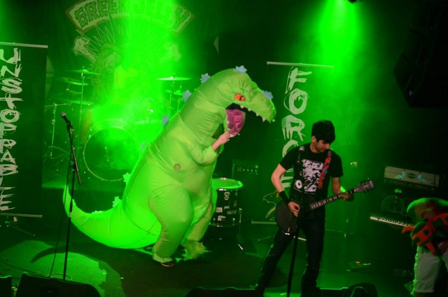 At an Unstoppable Force show, it's not uncommon to have a dino headbanging to a song while the band plays on stage. Photo taken at the Whiskey A Go-Go venue by Mathias Fau.