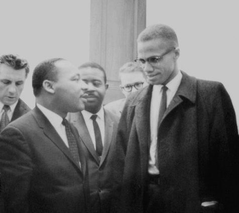 Martin Luther King and Malcolm X waiting for press conference. People celebrate King while denigrating X but both held radical visions for a different America.
