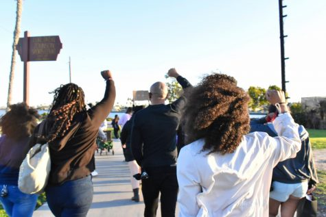 Participants in the Black History Month Celebration marched in solidarity with others to remember African-American