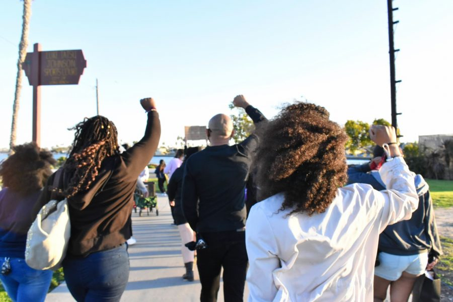 Participants in the Black History Month Celebration marched in solidarity with others to remember African-American's role in shaping America. The march took place at Marina Park in Long Beach on February 20, 2021.
