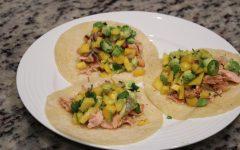 Salmon fish tacos with mango lime salsa ready to eat. Feb 6, 2021 Photo credit: Lola Ajetunmobi