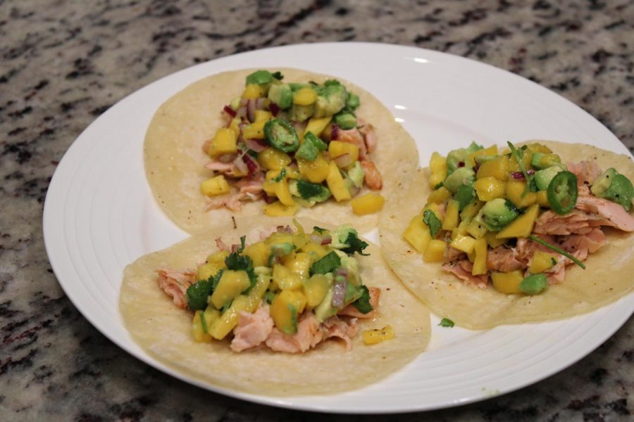 Salmon fish tacos with mango lime salsa ready to eat. Feb 6, 2021