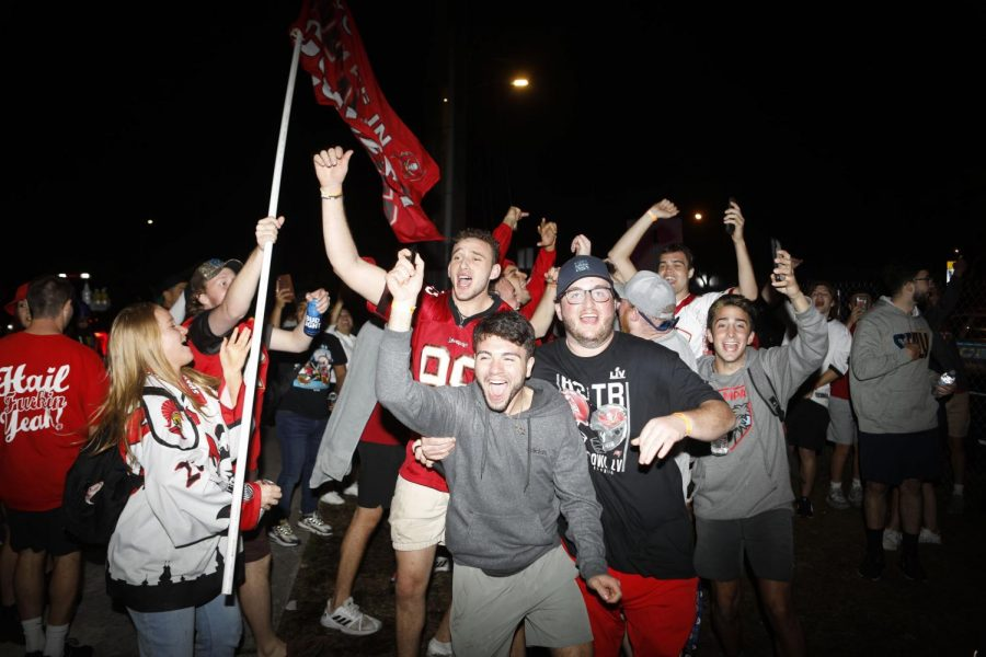 Tampa Bay Buccaneers fans celebrate during Super Bowl 55 near Raymond James Stadium on Sunday.